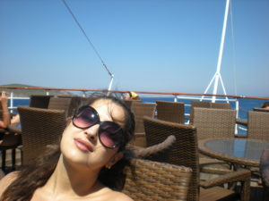 life turning point on Patmos-dina al hidiq zebib sitting on cruise ship deck